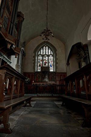 jane: English church interior view looking at alter choir stalls and organ
