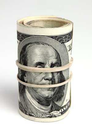 hundred dollar bills tied with a rubber Stock Photo