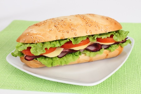 ham and cheese sandwich with lettuce and fresh tomato Stock Photo