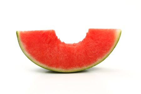 bite piece of ripe watermelon in half Фото со стока