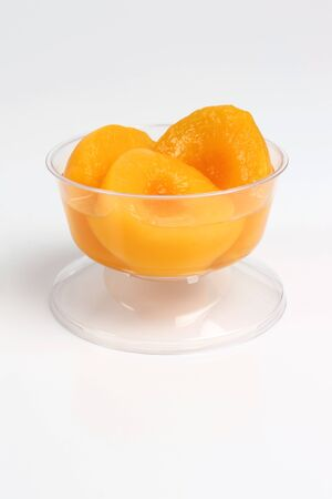 several pieces of peaches in plastic container Stok Fotoğraf