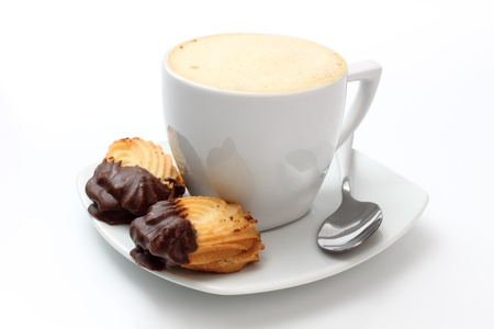 cup of coffee and two chocolate cookies photo