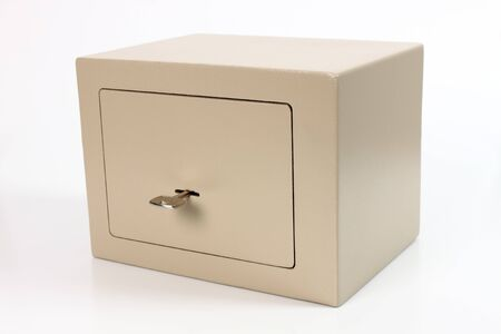 Metal safety deposit box on white background with key Stock Photo