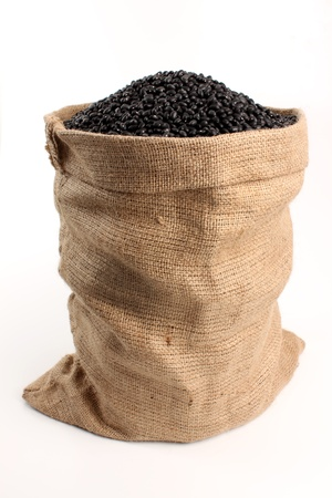 sack of black beans on a white background