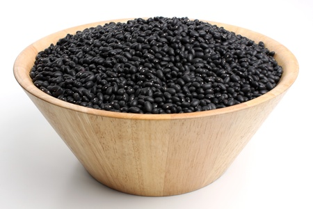 deep wooden bowl filled with black beans