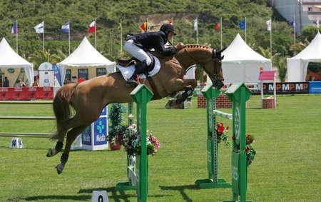 VIMEIRO, PORTUGAL - JUNE 5: Equestrian International Show Jumping 3* - Sebast Numminen  (FIN) June 5, 2010 in Vimeiro, Portugal Stock Photo - 7124272