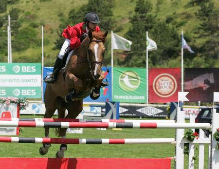 VIMEIRO, PORTUGAL - JUNE 6: Equestrian International Show Jumping 3* - Tiago Quintas (POR) June 6, 2010 in Vimeiro, Portugal Stock Photo - 7124273