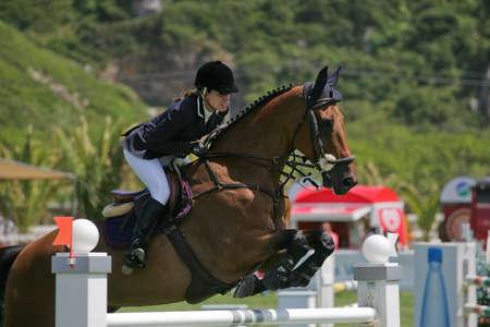 VIMEIRO, PORTUGAL - JUNE 5: Equestrian International Show Jumping 3* - Natalia Golding (ESP) June 5, 2010 in Vimeiro, Portugal Stock Photo - 7124277