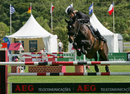 VIMEIRO, PORTUGAL - JUNE 5: Equestrian International Show Jumping 3* - Laura Renwick (GBR) June 5, 2010 in Vimeiro, Portugal Stock Photo - 7124280