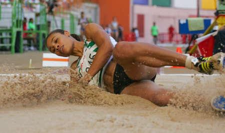 salto largo: LEIRIA, PORTUGAL - el 18 de julio: Campeonato de atletismo de portugu�s, las mujeres de salto de longitud Naide Gomes (SCP), el 18 de julio de 2010 en Leiria, Portugal