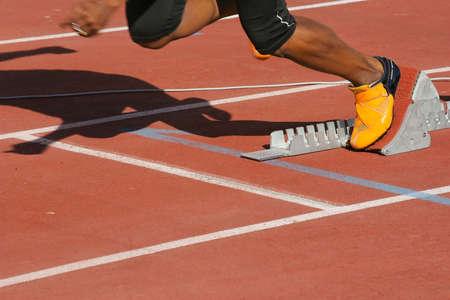 athlete in start blocks