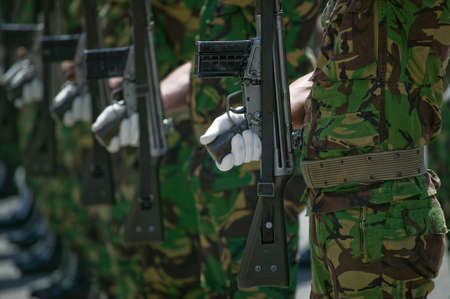 man holding gun: Soldiers in army Parade