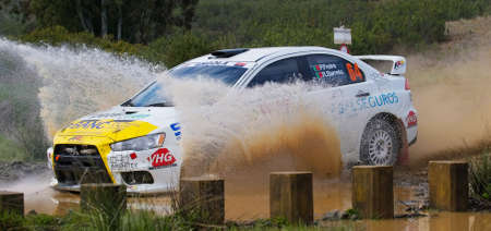 ALGARVE, PORTUGAL - MARCH 31: Paulo Freire (POR) driving is Mitsubishi Lancert in Rally de Portugal 2012 on March 31, 2012 in Algarve, Portugal Stock Photo - 13062389