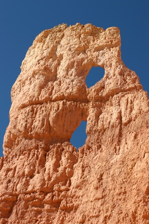 Bryce Canyon - Two Holes In The Rock Against A Bright Blue Sky Stock Photo - 13271834