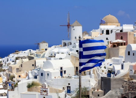 Oia Windmills And Greek Flags - Santorini Island photo