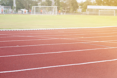 sun track: Running track around the football field with the evening sun
