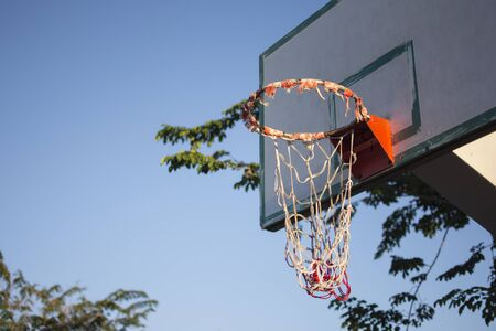 The basketball hoop dilapidated need of repair.