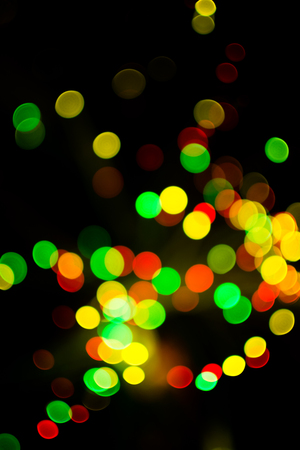 Colorful bokeh light celebrate at night, defocus light abstract yello background.
