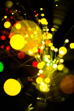 yello: Colorful bokeh light celebrate at night, defocus light abstract yello background.