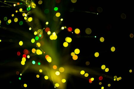 yello: Colorful bokeh circle light celebrate at night, defocus light abstract yello background.
