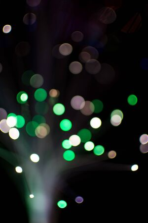 de focused: Colorful bokeh circle light celebrate at night, defocus light abstract green background.
