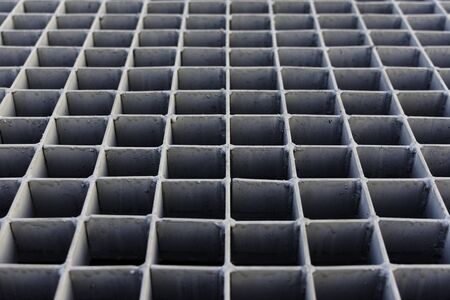 gratings: The gray metal grating on the street drain. Stock Photo
