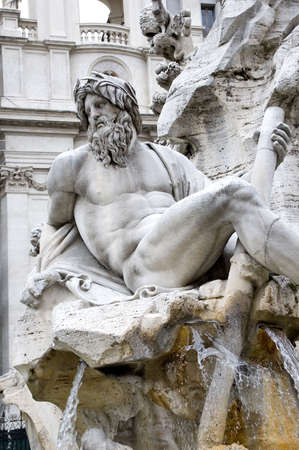Detail of the Fountain of the Four Rivers - Piazza Navona - Rome. Фото со стока