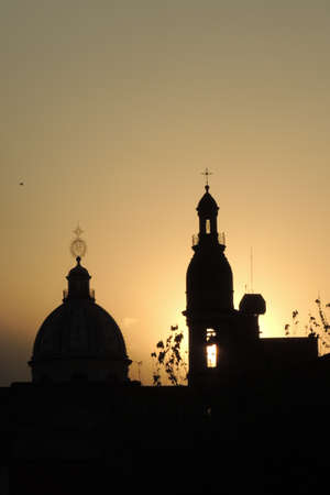 the backlighting: cupolas of churches in a golden sunset backlighting
