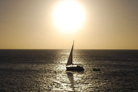 seaway: Sunset with sea and sun on a sailboat