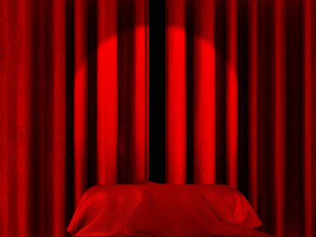 Spot light pointing to a blanket or a box covered with silk on a stage photo