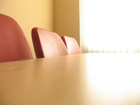 Red chairs in a meeting room and window with curtains photo