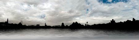 Egyptian panorama with Giza Pyramids, Cairo Citadel, Mosque, Church and palm trees on the Nile river during sunset photo