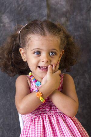 blonde  blue eyes: Portrait of a cute little girl in pink dress