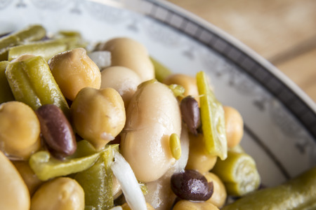 lima beans white beans: Close up of beans salad with onion on wood background