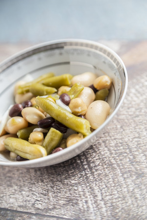 lima bean: beans salad with onion on wood background Stock Photo