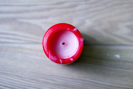 flame like: Unlit red candle on wooden board