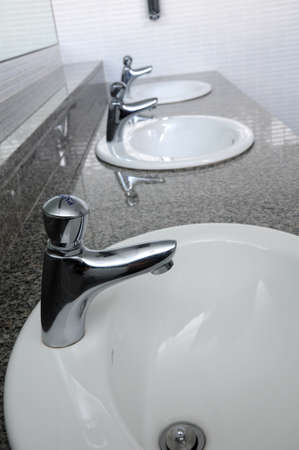 Row of faucets in  toilet at my office Stock Photo - 7619447