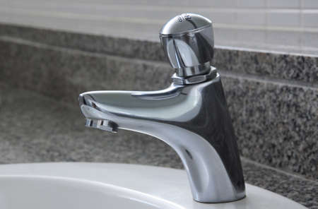 Chrome Faucet in toilet at my office Stock Photo - 7619454