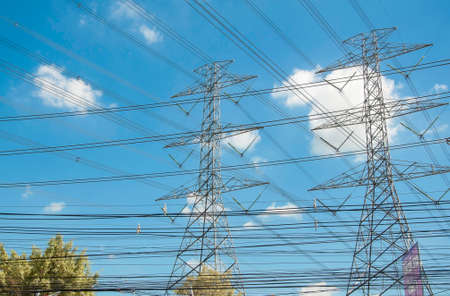 megawatt: High voltage post or High voltage tower and blue sky Stock Photo