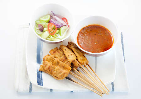 satay sauce: Grilled pork satay, peanut sauce and vinegar on white background Stock Photo