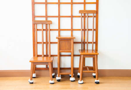 small table: Old wooden chairs with a small table