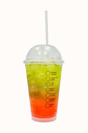 Green and red italian soda in the plastic cup ice water