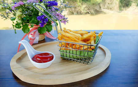 French fries in basket served with ketchup