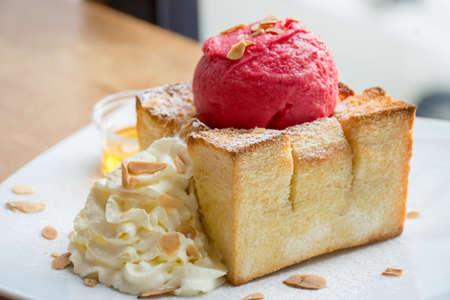 Honey toast with raspberry sorbet ice cream and whipping cream