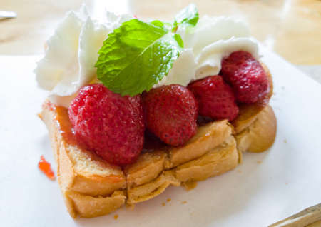 Toast bread with strawberry and whipping cream Stock Photo