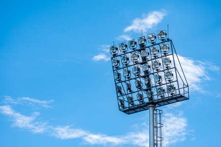 Stadium spot light with blue sky background