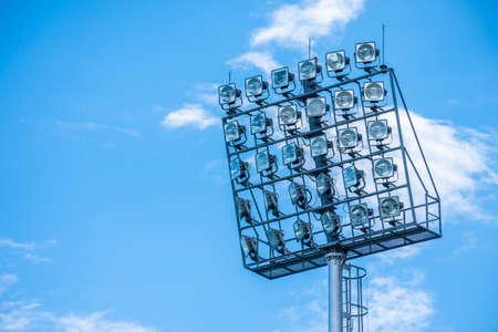 Stadium spot light with blue sky background