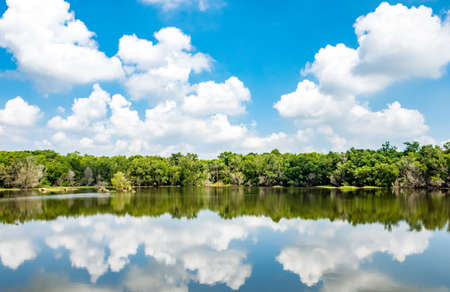Landscape of lake and forest with blue sky and clouds Stock Photo