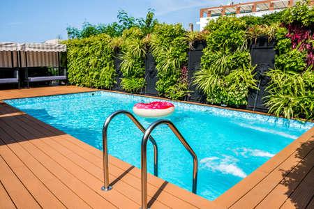 Modern swimming pool in the garden Stock Photo