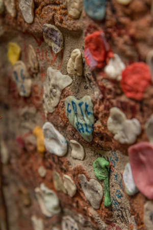 love proof: Bubble gum stuck on wall Stock Photo